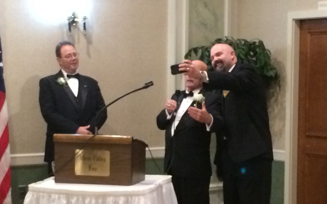"""Bro. Bob Fish is given instruction during the """"Selfy"""" Degree by Most Worshipful Wyman P. Hallstrom III"""